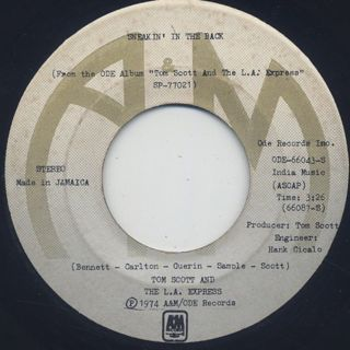 Tom Scott And The L.A. Express / Strut Your Stuff c/w Sneakin' In The Back back